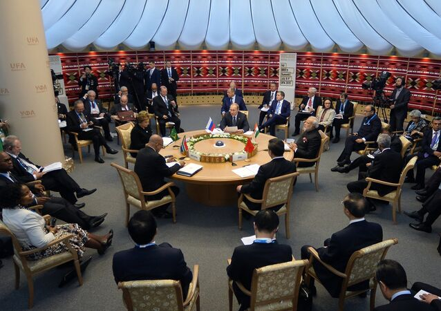 Brazil's President Dilma Rousseff, South Africa's President Jacob Zuma, Russia's President Vladimir Putin, Chinese President Xi Jinping and Indian Prime Minister Narendra Modi sit around the table during a working session at the 7th BRICS summit in Ufa on July 9, 2015