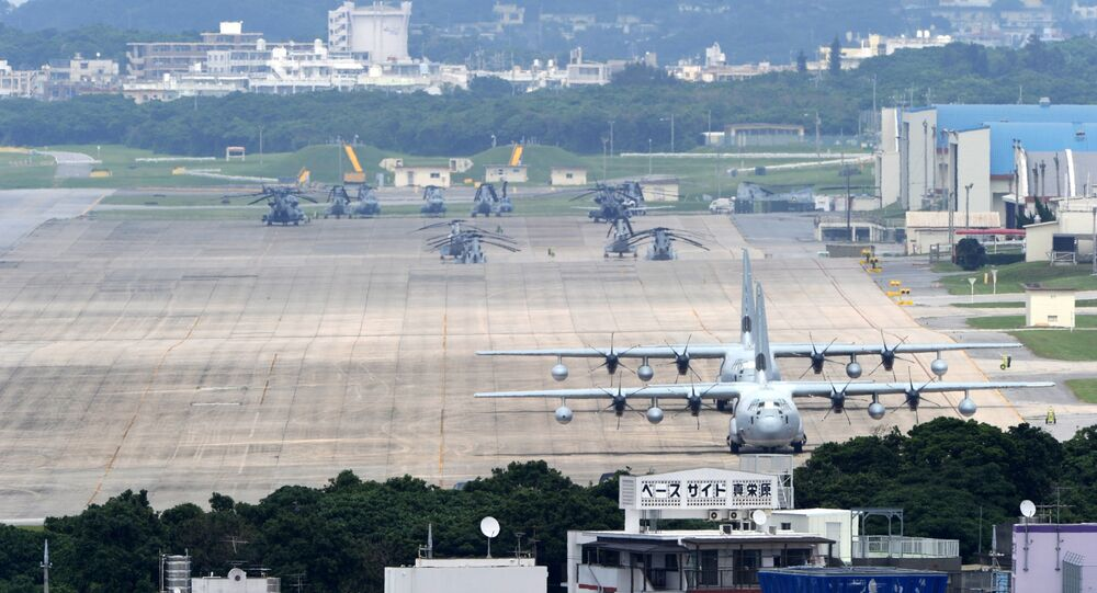 A file picture taken on April 24, 2010 shows planes and helicopters stationed at the US Marine Corps Air Station Futenma base in Ginowan, Okinawa prefecture.