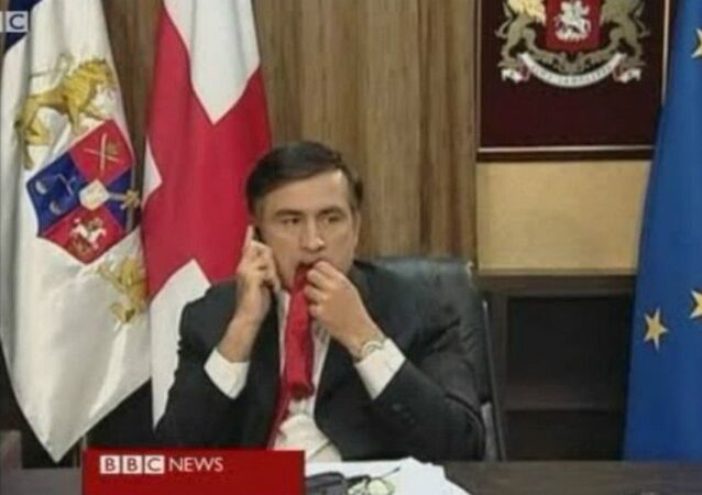Saakashvili chewing his tie as he waited for a BBC interview.