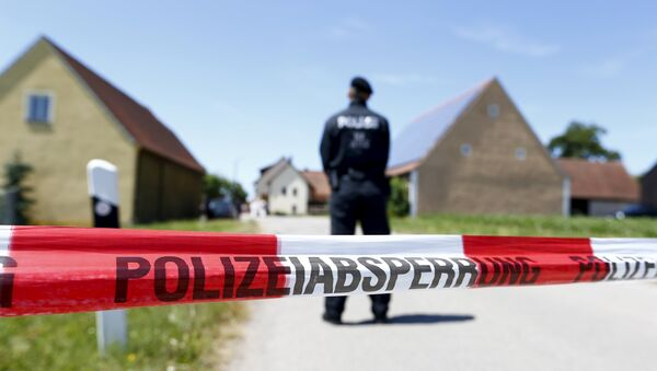 A police tape and a German police officer are seen in Tiefenthal near Ansbach, Germany, July 10, 2015 - Sputnik International