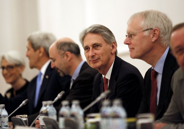 British Foreign Secretary Philip Hammond (C) attends a meeting with foreign ministers and representatives of United States, France, Germany, China, Russia and the European Union during nuclear talks at a hotel in Vienna, Austria July 10, 2015