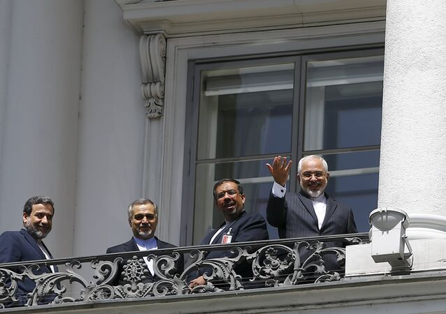 Iranian Foreign Minister Javad Zarif (R) listens to questions from journalists as he stands next to Iran's chief nuclear negotiator Abbas Araghchi (L) and Hossein Fereydoon (2nd L), brother and close aide to President Hassan Rouhani, on the balcony of Palais Coburg, the venue for nuclear talks in Vienna, Austria, July 10, 2015