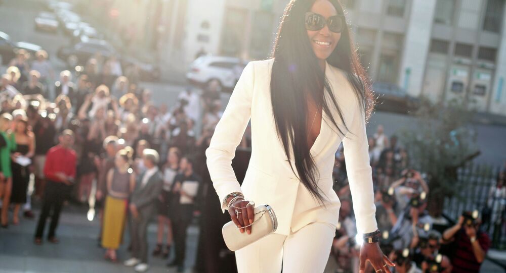 British model Naomi Campbell arrives for the Versace's fall-winter 2015/2016 Haute Couture fashion collection presented in Paris, France, Sunday, July 5, 2015