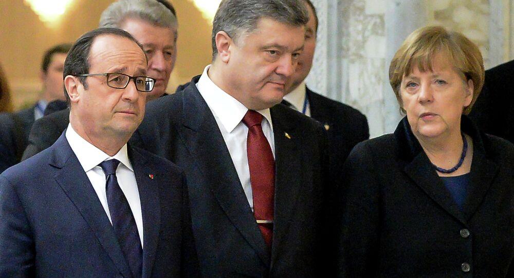France's President Francois Hollande, Ukrainian President Petro Poroshenko and German Chancellor Angela Merkel (L-R) walk for a family photo at the presidential residence in Minsk on February 11, 2015