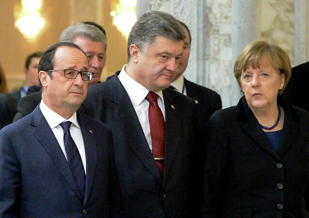 France's President Francois Hollande, Ukrainian President Petro Poroshenko and German Chancellor Angela Merkel (L-R) walk for a family photo at the presidential residence in Minsk on February 11, 2015