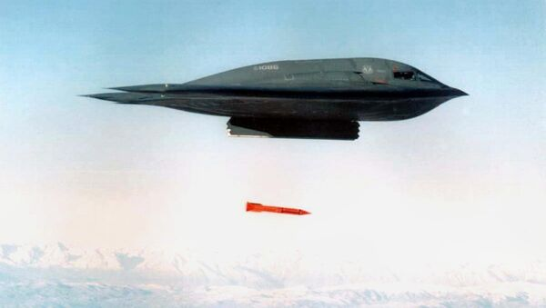 An undated file picture shows a B-2 Spirit Bomber droping a B61-11 bomb casing from an undisclosed location - Sputnik International