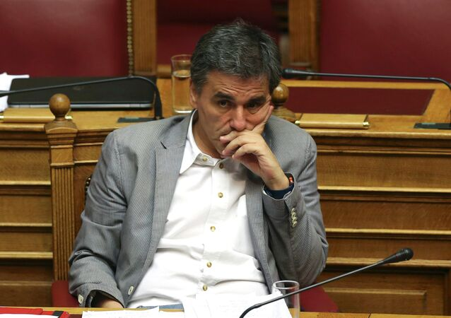 Greek Finance Minister Euclid Tsakalotos attends a parliamentary session in Athens, Greece, July 10, 2015