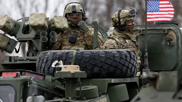 Members of US Army's 2nd Cavalry Regiment ride on an armored vehicle during the ''Dragoon Ride'' military exercise in Salociai some 178 kms (110 miles) north of the capital Vilnius, Lithuania, Monday, March 23, 2015 - Sputnik International