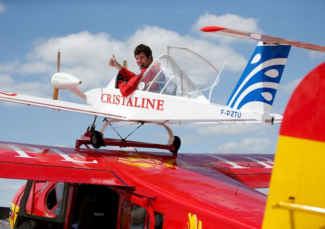 Pilot Hugues Duval in his twin-engined Cri-Cri, one of the world's smallest electrical planes, waits to take off from an old Broussard aircraft, on which it is attached to, during a flying display at the 51st Paris Air Show at Le Bourget airport near Paris, June 19, 2015