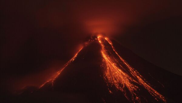 Lava flows down the banks of the Colima Volcano, also known as the Volcano of Fire, near the town of Comala, Mexico, Friday, July 10, 2015 - Sputnik International