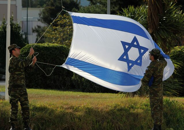 Greek soldiers hang the Israeli flag before the visit of Defense Minister Ehud Barak in Athens, Tuesday, Jan. 10, 2012