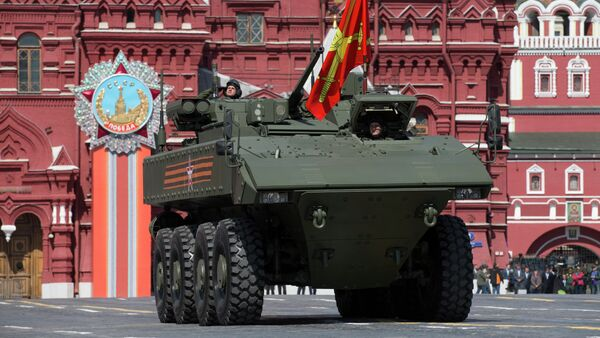 Bumerang armored personnel carrier drives during the Victory Parade marking the 70th anniversary of the defeat of the Nazis in World War II, in Red Square in Moscow, Russia, Saturday, May 9, 2015 - Sputnik International