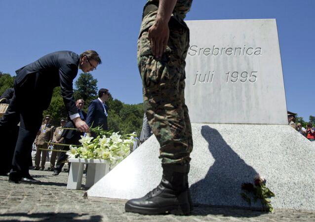 Serbia's Prime Minister Aleksandar Vucic lays flowers during a ceremony marking the 20th anniversary of the Srebrenica massacre in Potocari, near Srebrenica, Bosnia and Herzegovina July 11, 2015