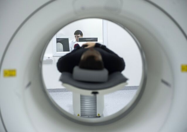 A technician performs an MRI scan. File photo