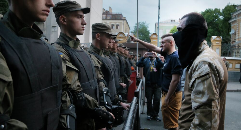 Activists from the Right Sector party confront police who are blocking a street leading to the Ukrainian Presidential administration building in Kiev, Ukraine, Saturday, July 11, 2015