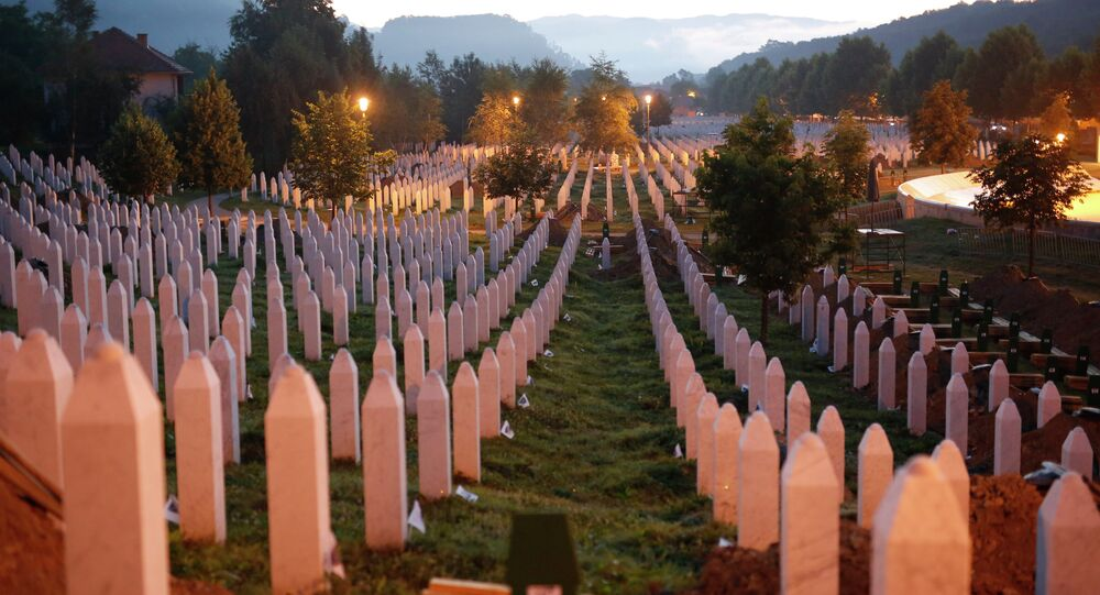 Gravestones are seen at sunrise at a memorial complex near Srebrenica, 150 kilometers (94 miles) northeast of Sarajevo, Bosnia and Herzegovina, Saturday, July 11, 2015