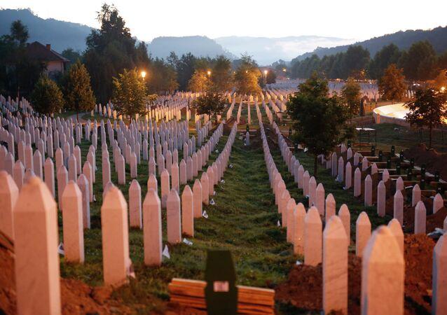 Gravestones are seen at sunrise at a memorial complex near Srebrenica, 150 kilometers (94 miles) northeast of Sarajevo, Bosnia and Herzegovina, Saturday, July 11, 2015