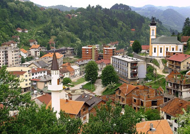 This March 2005 file photo shows a general view of the eastern Bosnian town of Srebrenica, with its mosque (L) and Orthodox church (R)