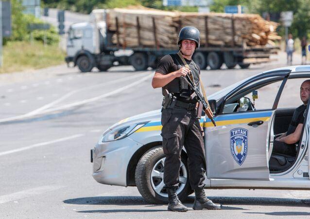 National Guard servicemen man a road block in the village of Lavky, near the small Ukrainian town of Mukachevo, Transcarpathia district, on July 12, 2015