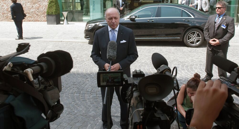 French Foreign Minister Laurent Fabius speaks to journalists in front of the Palais Coburg Hotel, where the Iran nuclear talks meetings are being held, in Vienna, Austria on July 12, 2015