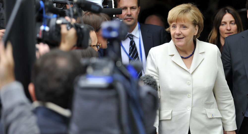 German Chancellor Angela Merkel (R) arrives for a meeting of European Popular Parties (EPP), on July 12, 2015, in Brussels