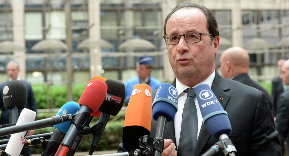 French President Francois Hollande gives a press point as he arrives for a meeting in Brussels of the leaders of the 19 countries that use the euro, on July 12, 2015