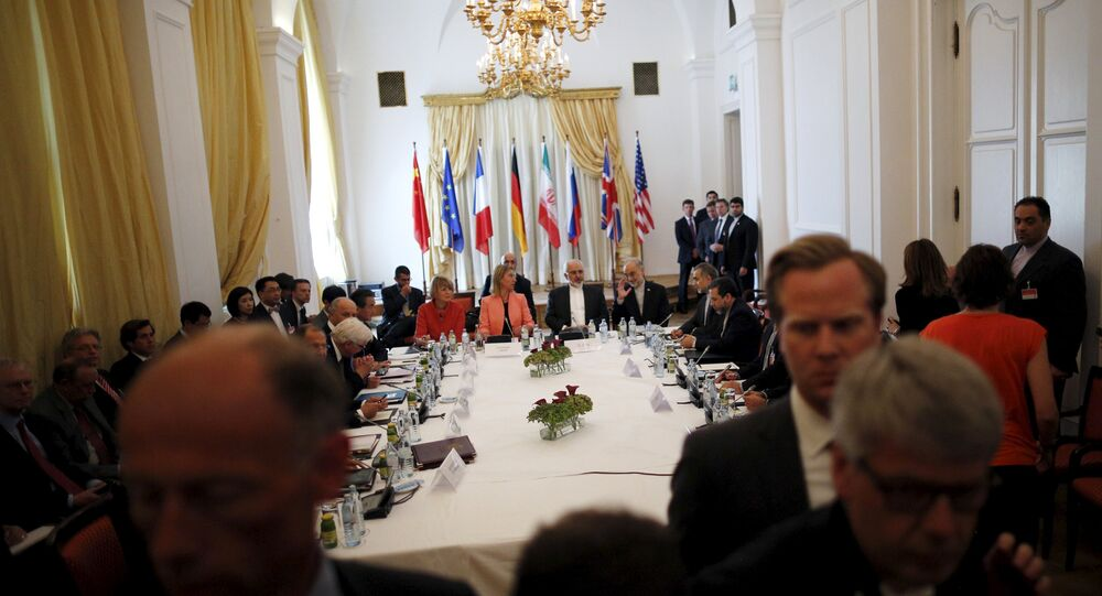 Iranian Foreign Minister Mohammad Javad Zarif (C) sits next to European Union High Representative for Foreign Affairs and Security Policy Federica Mogherini as they meet with foreign ministers from the U.S., France, Russia, Germany, China and Britain at the hotel where the Iran nuclear talks meetings are being held in Vienna, Austria July 6, 2015