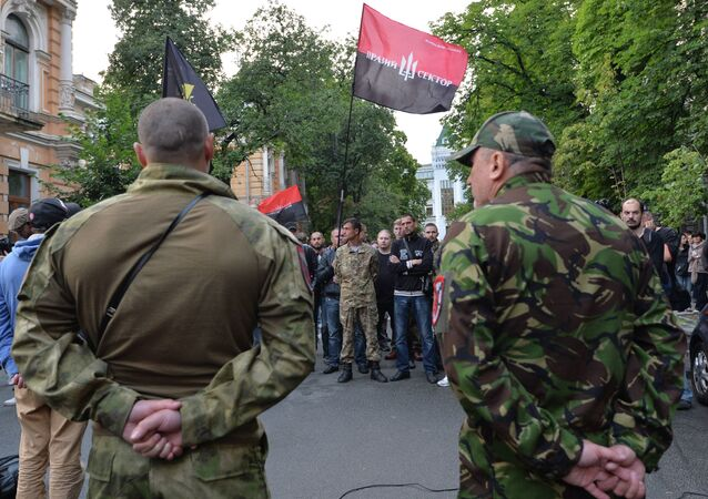 Members of the Pravy Sektor movement and their supporters rally in front of the Presidents administration in Kiev on July 11, 2015, in support of their comrades