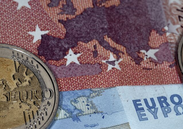 This photo taken in Athens on July 11, 2015 the map of Europe represented on a euro coin and banknotes