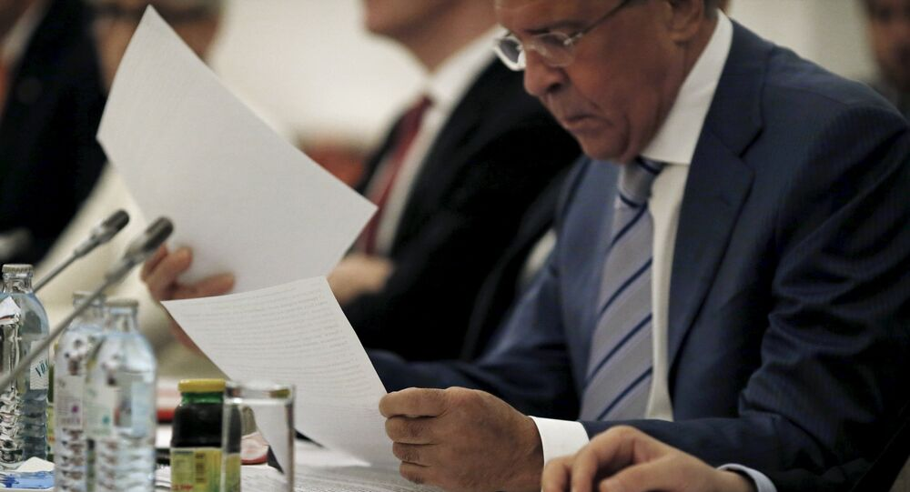 Russian Foreign Minister Sergei Lavrov reads documents during a meeting with foreign ministers and delegations from Germany, France, China, Britain, the U.S. and the European Union at a hotel in Vienna, Austria July 13, 2015
