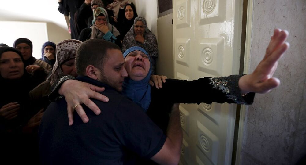 The mother of Palestinian youth Mohammed Sami al-Ksbeh, 17, mourns during his funeral in Qalandiya refugee camp, near the West Bank city of Ramallah July 3, 2015.