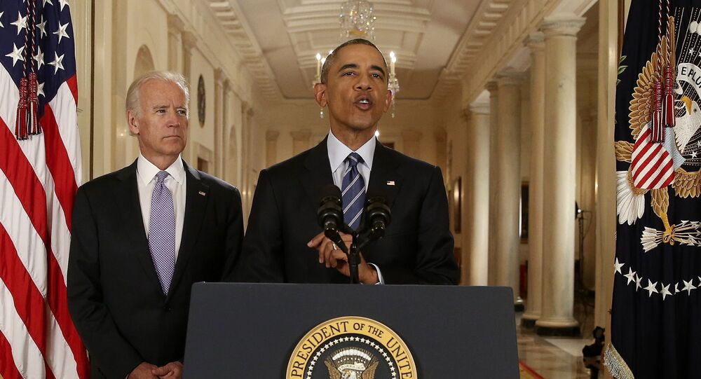 US President Barack Obama speaks with Vice President Joe Biden at his side as he delivers a statement about the nuclear deal reached between Iran and six major world powers during an early morning address to the nation from the East Room of the White House in Washington, 14 July 2015. REUTERS/Andrew Harnik/Pool
