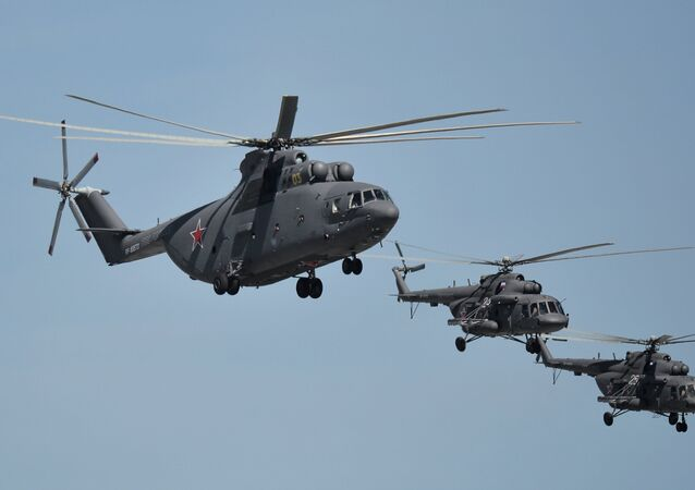 A Mil Mi-26 Halo and Mil Mi-8 Hip helicopters