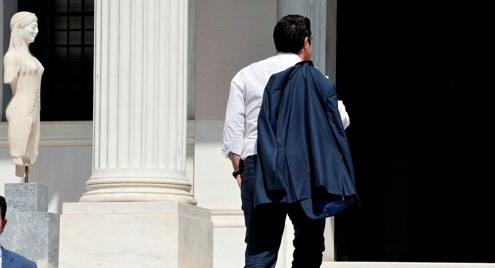 Greek Prime Minister Alexis Tsipras arrives at his office in Athens just after flying in from Brussels on July 13, 2015.