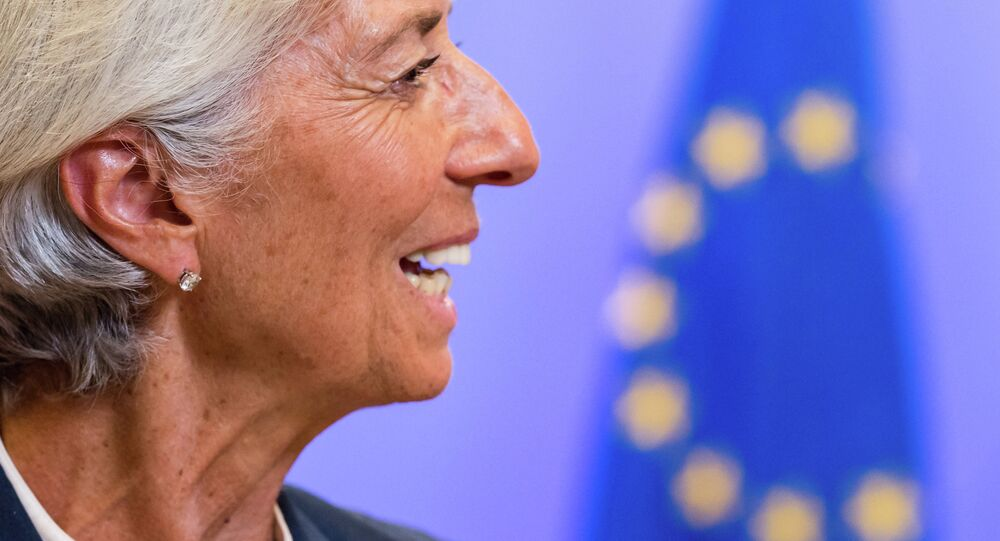 Managing Director of the International Monetary Fund Christine Lagarde smiles as she leaves after a meeting of Eurozone heads of state at the EU Council building in Brussels on Monday, July 13, 2015.