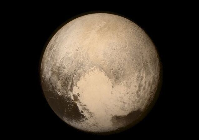 Pluto nearly fills the frame in this image from the Long Range Reconnaissance Imager (LORRI) aboard NASA's New Horizons spacecraft, taken on July 13, 2015, when the spacecraft was 476,000 miles (768,000 kilometers) from the surface and released on July 14, 2015