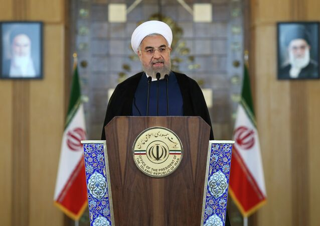 Iran's President Hassan Rouhani addresses the nation in a televised speech after a nuclear agreement was announced in Vienna, in Tehran, Iran, Tuesday, July 14, 2015.