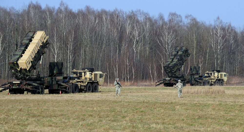 US troops from the 5th Battalion of the 7th Air Defense Regiment emplace a launching station of the Patriot air and missile defence system