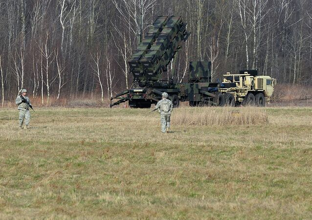 US troops from the 5th Battalion of the 7th Air Defense Regiment emplace a launching station of the Patriot air and missile defence system at a test range in Sochaczew, Poland.file photo