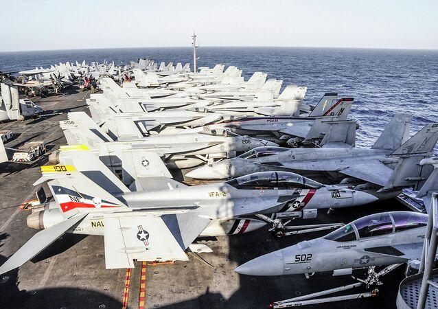 Aircraft line the flight deck of the aircraft carrier USS Ronald Reagan