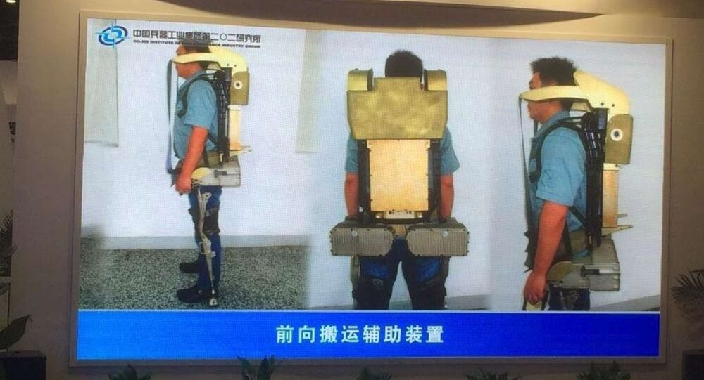 The new Chinese exoskeleton has improved performance, including an add on crane/lifter on the upper body, to add in lifting heavy objects.