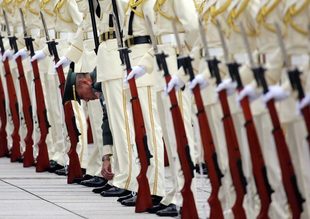 FILE - In this Wednesday, June 3, 2015 file photo, Japan Self-Defense Forces' honor guard prepares to welcome Australian Defense Minister Kevin Andrews and his Japanese counterpart Gen Nakatani at the Defense Ministry in Tokyo.