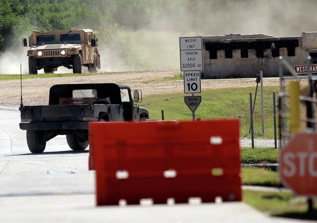 Military vehicles are seen at Texas Army National Guard Camp Swift, Wednesday, July 15, 2015, in Bastrop, Texas. Jade Helm 15, a summer military training exercise, that has aroused alarm among archconservative Texans, begins Wednesday outside the Central Texas town of Bastrop.