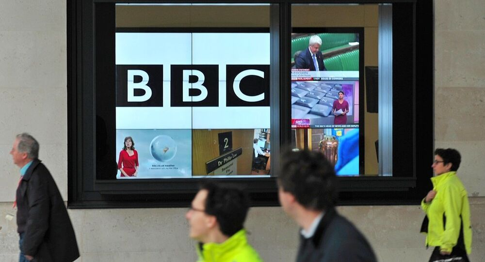 A BBC logo is pictured on a television screen inside the BBC's New Broadcasting House office in central London, on November 12, 2012.