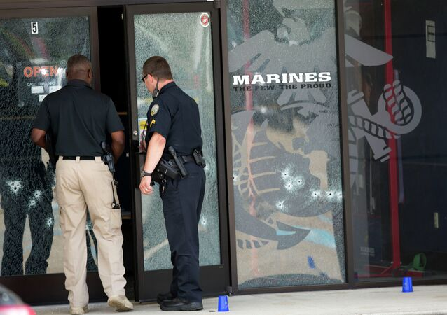 Police officers enter the Armed Forces Career Center through a bullet-riddled door after a gunman opened fire on the building Thursday, July 16, 2015, in Chattanooga, Tenn.
