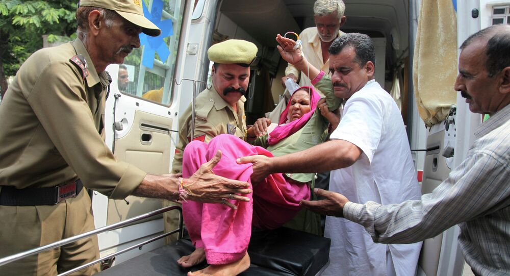 An Indian civilian woman injured in exchange of fire by troops on the India Pakistan border is brought for treatment at the government medical college hospital in Jammu, India, Wednesday, July 15, 2015.