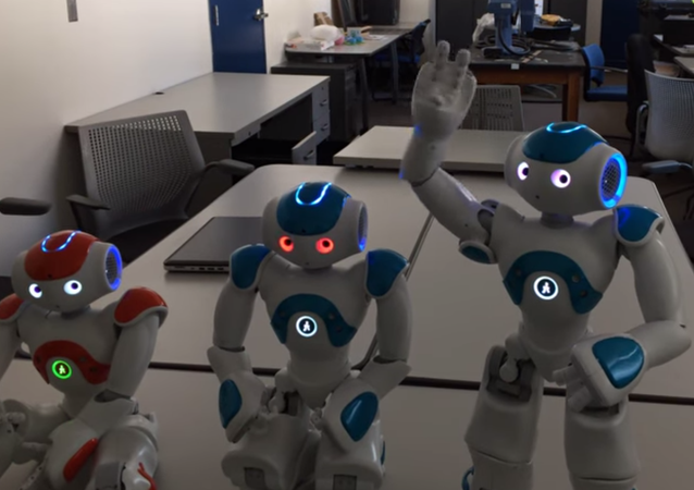 Three robots at the Ransselaer Polytechnic Institute in New York are put through a self-awareness test.