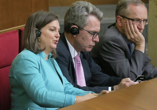 U.S. Assistant Secretary of State Victoria Nuland, foreground, listens, during a parliament session in Kiev, Ukraine Thursday, July 16, 2015