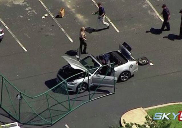 In this aerial image taken from video, law enforcement personnel work the scene of a shooting at the Navy Operational Support Center and Marine Corps Reserve Center Chattanooga Thursday, July 17, 2015, in Chattanooga, Tenn