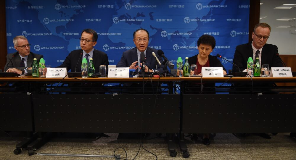 World Bank President Jim Yong Kim (C) speaks at a press conference in Beijing on July 17, 2015